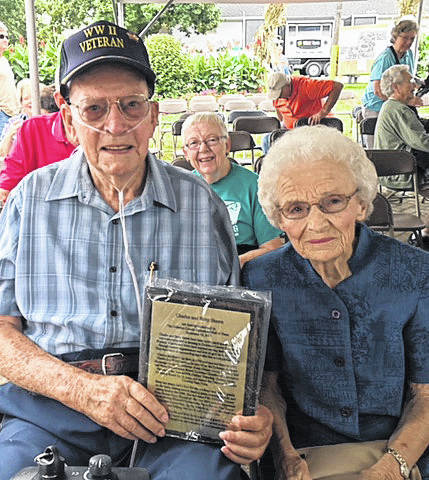 Charles and Betty Sheets were inducted into the Delaware County Agricultural Hall of Fame during this year's fair. The Sheets proudly display the plaque they received during their recognition and induction.