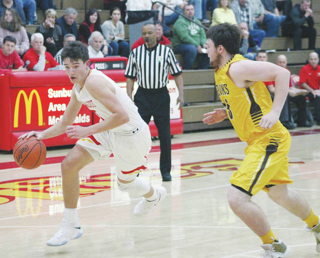 Big Walnut's Carson Becker, left, drives toward the hoop as Buckeye Valley's Austin Richard defends during the first half of last Friday's non-league showdown in Sunbury.