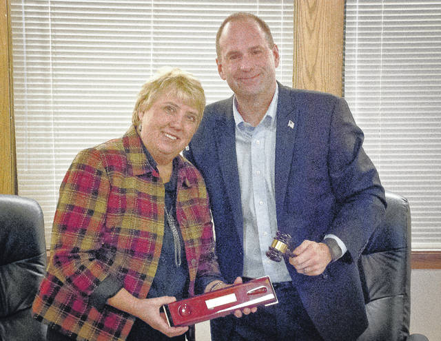 Orange Township Trustee Rob Quigley was presented with a gavel by Trustee Debbie Taranto as a memento of his time serving the township Monday evening, Dec. 18. Taranto said he was perfect for the job as trustee.