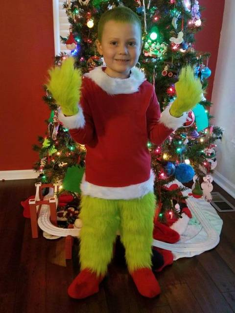 Kai as the Grinch.