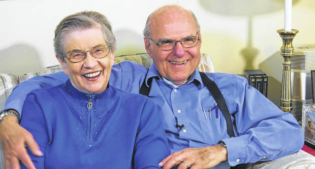 Tom Moore, right, now takes care of his wife, LaVonne, left, who has Alzheimer's disease. Three years ago LaVonne participated in a deep brain stimulation study using an implanted pacemaker. The electrical impulses to specific parts of her brain slowed the progression of her symptoms, allowing her to retain functionality longer.