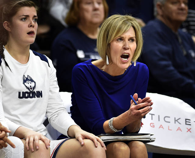 Connecticut Assoc. Head Coach Chris Dailey shouts instructions from the bench in the second half of an NCAA college basketball game against Louisville Monday, Feb. 12, 2018, in Storrs, Conn. It was announced Monday night that Dailey will be an inductee into the Women's Basketball Hall of Fame. UConn won 69-58. (AP Photo/Stephen Dunn)