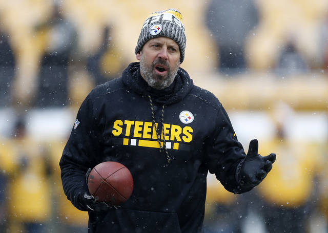 FILE - This Dec. 31, 2017 file photo shows Pittsburgh Steelers offensive coordinator Todd Haley watching warm ups before an NFL football game against the Cleveland Browns in Pittsburgh. After six successful seasons guiding one of the NFL's most high-powered offenses in Pittsburgh, Haley is starting anew in Cleveland with the winless Browns, a team he once reviled but has always respected. (AP Photo/Keith Srakocic, file)