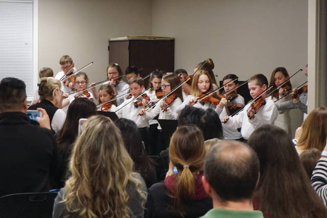 Students in the Big Walnut Intermediate Orchestra perform at the Board of Education meeting in Sunbury on Feb. 15.