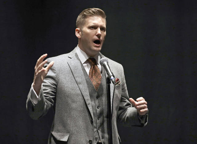 FILE - In this Oct. 19, 2017, file photo, white nationalist Richard Spencer speaks at the University of Florida in Gainesville, Fla. Spencer plans to speak March 5, 2018, at Michigan State University, but the rest of his campus tour has bogged down for now in lawsuits or lack of agreement on timing. (AP Photo/Chris O'Meara, File)