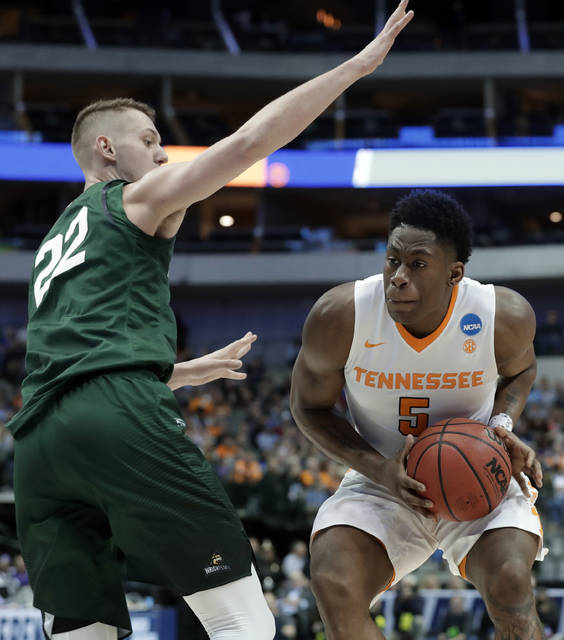Wright State center Parker Ernsthausen (22) defends as Tennessee forward Admiral Schofield (5) positions for a shot in the first half of the first round of the NCAA men's college basketball tournament in Dallas, Thursday, March 15, 2018. (AP Photo/Tony Gutierrez)