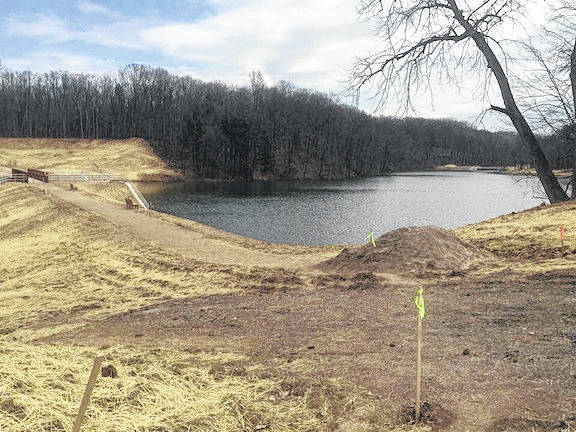 Work on Mount Gilead State Park dam is progressing. Refilling of lake is under way following substantial completion of a project to construct a new dam and spillway. ODNR says the lake is about 2½ feet below normal pool and should reach full pool sometime in March. Gamefish will be restocked into the lake beginning in spring to reestablish a sport fishery in the lake. Part of the project also includes a newly constructed canoe/kayak launch in the upper end of the lake. Various additional park amenities will be completed this spring and include final seeding, mulching and other landscape improvements at the job site, tree planting, parking lot improvements, and placement of signage, park benches and fishing line collectors.