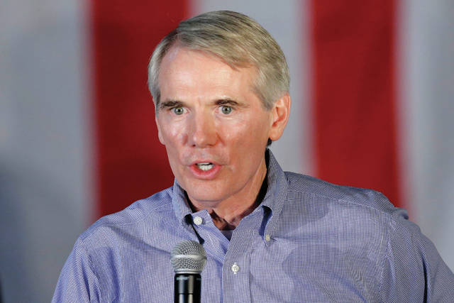 FILE  In this Sept. 29, 2014, file photo, U.S. Sen. Rob Portman, R-Ohio, promotes Republican voter turnout during a rally in Independence, Ohio. Republican U.S. Sen. Rob Portman and the Democratic nominee challenging Portman's bid for re-election, former Ohio Gov. Ted Strickland, agreed to three debates, Friday, Oct. 14, 2016, in Youngstown, Ohio; Monday, Oct. 17, 2016, in Columbus, Ohio, and on Thursday, Oct. 20, 2016, in Cleveland. (AP Photo/Mark Duncan, File)