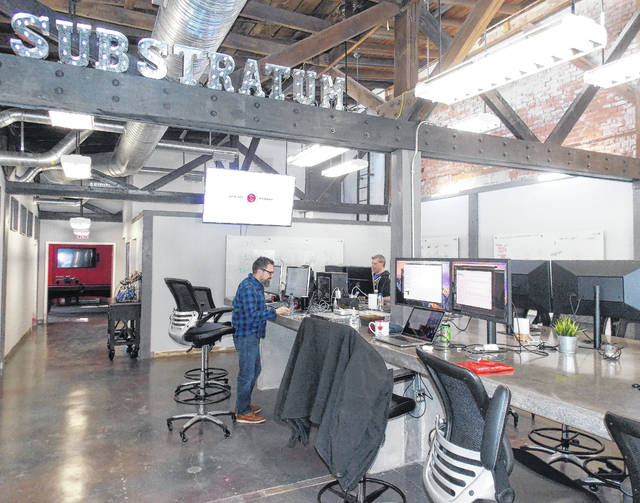 Substratum COO and co-founder B.J. Allmon, left, and Chief Tech Officer Steve Swing, right, work inside the Substratum office at 23 N. Union St. in downtown Delaware. The company focuses on creating a decentralized web and building products and services centered around cryptocurrency transactions.