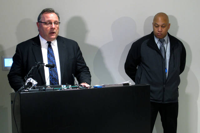 Westerville, Ohio Police Chief Joe Morbitzer, left, discusses the indictment against the man accused of killing two officers with the suburban department in February in a case carrying the possibility of a death sentence, at a news conference attended by Columbus police Detective Gregory Sheppard, right, on Friday, March 23, 2018, in Columbus, Ohio. Morbitzer said he's confident justice will be done in the case. (AP Photo/Andrew Welsh-Huggins)