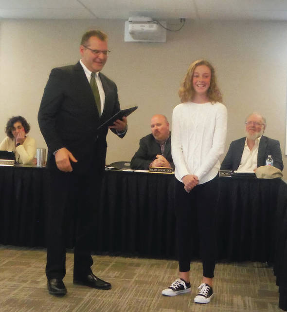 School Board President Andy Wecker introduces Giana Vitale as the Big Walnut Intermediate Student of the Month at its meeting on April 19 in Sunbury.