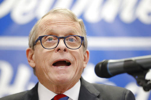 FILE- In this Nov. 30, 2017, file photo, Ohio Attorney General and former U.S. Sen. Mike DeWine speaks before introducing Ohio Secretary of State Jon Husted during a news conference in Dayton, Ohio. Records show a Cincinnati anti-abortion activist was in regular contact with DeWine's office during a probe of Planned Parenthood and that some of her advice was passed on to state investigators. (AP Photo/John Minchillo, File)