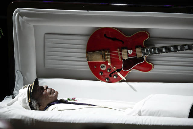 File- This April 9, 2017, file photo shows a Gibson ES-335 is attached to the lid of Chuck Berry's casket during a celebration of life for the rock 'n' roll legend in St. Louis. The maker of the Gibson guitar, omnipresent for decades on the American music stage, is filing for bankruptcy protection after wrestling for years with debt. A pre-negotiated reorganization plan filed Tuesday, May 1, 2018, will allow Gibson Brands Inc. to continue operations with $135 million in financing from lenders. (AP Photo/Jeff Roberson, File)
