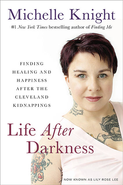This image provided by Hachette Books shows the cover of Michelle Knight's book Life After Darkness. Five years after being rescued from a decade-long captivity in chains inside a heavily fortified Cleveland house, kidnapping survivor Knight published her second book, focusing on her recovery and life afterward, including her marriage. (Deborah Feingold Photography/Hachette Books via AP)