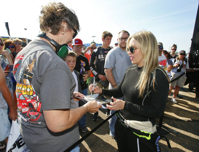 FILE - In this May 22, 2016, file photo, Top Fuel driver Brittany Force greets fans prior to her first elimination run of the day at the NHRA Kansas Nationals in Topeka, Kan. Leah Pritchett and Courtney Force left the NHRA Southern Nationals in Atlanta with winner trophies but far less attention than Danica Patrick received for simply turning laps again at Indianapolis Motor Speedway. The difference between Patrick and the women of NHRA is that they know they can win races and do it routinely. Drag racing is perhaps the most diverse racing series in the world and has always welcomed female drivers. (Chris Neal/The Topeka Capital-Journal via AP, File)