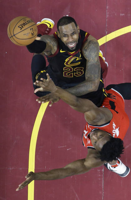 Cleveland Cavaliers' LeBron James shoots against Toronto Raptors' OG Anunoby in the first half of Game 4 of an NBA basketball second-round playoff series, Monday, May 7, 2018, in Cleveland. (AP Photo/Tony Dejak)
