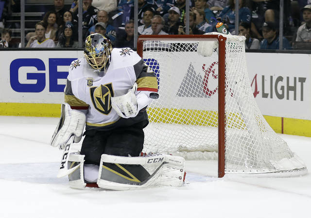 Vegas Golden Knights goaltender Marc-Andre Fleury stops a shot by the San Jose Sharks during the first period of Game 6 of an NHL hockey second-round playoff series Sunday, May 6, 2018, in San Jose, Calif. (AP Photo/Marcio Jose Sanchez)