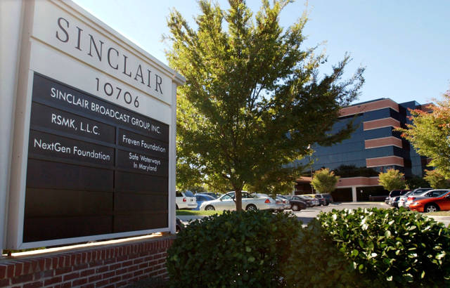 FILE - In thisOct. 12, 2004, file photo, Sinclair Broadcast Group, Inc.'s headquarters stands in Hunt Valley, Md.  Media company Twenty-First Century Fox is buying seven TV stations from Sinclair Broadcast Group for $910 million. The move comes as Sinclair is selling some stations to meet regulatory approval for its pending $3.9 billion acquisition of Tribune Media.     (AP Photo/Steve Ruark, File)