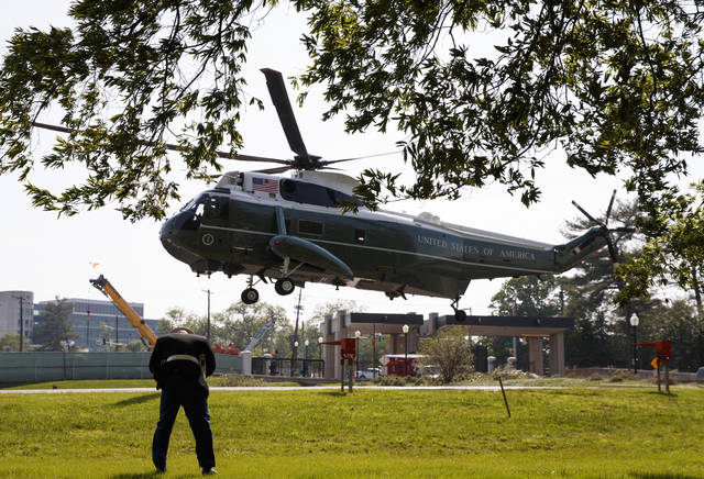 Marine One, with President Donald Trump aboard, arrives at Walter Reed National Military Medical Center in Bethesda, Md., Tuesday, May 15, 2018. The White House says Melania Trump is hospitalized after undergoing a procedure to treat a benign kidney condition. (AP Photo/Carolyn Kaster)