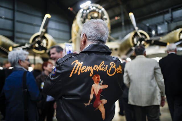 "Visitors gather for a private viewing of the Memphis Belle, a Boeing B-17 ""Flying Fortress,"" at the National Museum of the U.S. Air Force, Wednesday, May 16, 2018, in Dayton, Ohio. The World War II bomber Memphis Belle is set to go on display for the first time since getting a yearslong restoration at the museum. The B-17 ""Flying Fortress"" will be introduced Thursday morning as the anchor of an extensive exhibit in the Dayton-area museum's World War II gallery. (AP Photo/John Minchillo)"