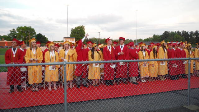 A passing shower delayed the Big Walnut High School's 68th annual Commencement in the football stadium by a half-hour, but a nice ceremony took place once the skies cleared. Here, students reach their seats during the processional. The Class of 2018 had 248 graduating seniors.