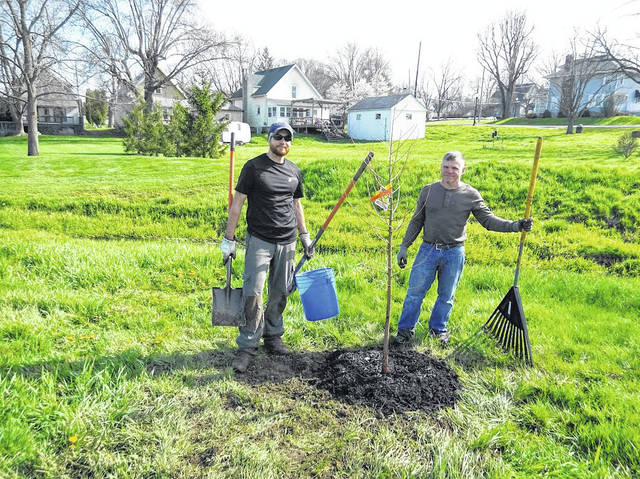 Preservation Arborist, Aaron Noblet, and former Councilman, Joe Gochenour, plant a tree along Prairie Creek.