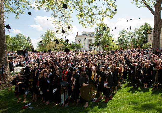 Ohio Wesleyan's 2018 commencement will be held at 1 p.m. May 12 on Merrick Lawn, outside Merrick Hall. Here, the Class of 2017 celebrates its just-completed graduation ceremony. (Photo by Lisa DiGiacomo)