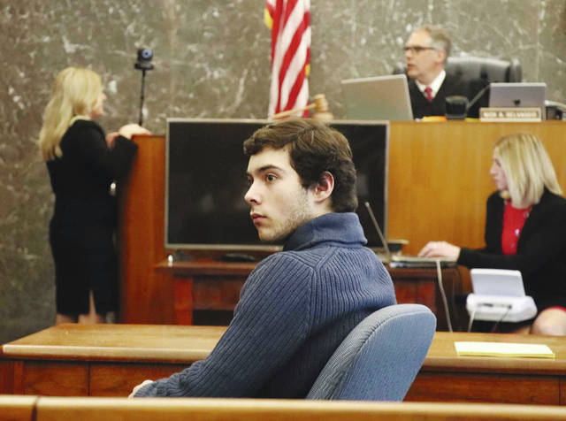 Ely Serna is shown in court during his sentencing on Wednesday. In the background is Champaign County Common Pleas Court Judge Nick Selvaggio.