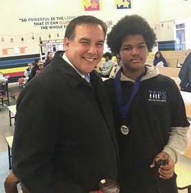 Mayor Ginther and 8th grader Dante Miles.