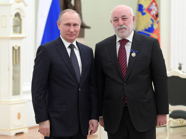FILE - In this Thursday, Jan. 26, 2017 file photo, Russian President Vladimir Putin, left, poses for a photo with Renova CEO businessman Viktor Vekselberg during an awarding ceremony in Moscow's Kremlin, Russia. Outside the rarified sphere of the super-rich, tycoon Viktor Vekselberg is mostly known in Russia for spending more than $100 million to bring cultural artifacts back to their homeland, including an array of Faberge eggs glittering with gold and jewels. (Alexei Druzhinin, Sputnik, Kremlin Pool Photo via AP, File)