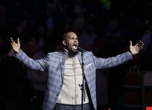 FILE - In this Nov. 17, 2015, file photo, musical artist R. Kelly performs the national anthem before an NBA basketball game between the Brooklyn Nets and the Atlanta Hawks in New York. As critics of the singer seek to cancel his shows because of his alleged mistreatment of women, a community leader in North Carolina says she and others will stage a protest if his Friday show in Greensboro takes place. (AP Photo/Frank Franklin II, File)