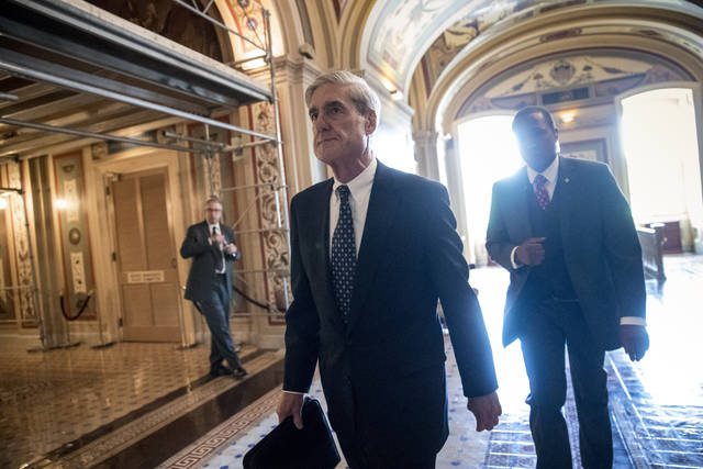 FILE - In this June 21, 2017, file photo, Special Counsel Robert Mueller departs after a closed-door meeting with members of the Senate Judiciary Committee about Russian meddling in the election at the Capitol in Washington. A year into his investigation, special counsel Robert Mueller is everywhere and nowhere at the same time. In that time, the breadth and stealth of his investigation has rattled the White House and its chief occupant, and has spread to Capitol Hill, K Street, foreign governments and, as late as last week, corporate boardrooms. (AP Photo/J. Scott Applewhite, File)
