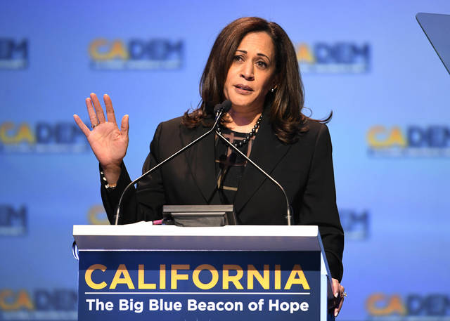 FILE - In this Feb. 24, 2018, file photo, Sen. Kamala Harris D-Calif., speaks at the 2018 California Democrats State Convention in San Diego. Look closely enough at the 2018 midterm campaign and you'll see the seedlings of a Democratic presidential campaign to reclaim the White House. (AP Photo/Denis Poroy, File)