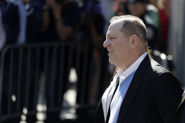 Harvey Weinstein leaves the first precinct of the New York City Police Department after turning himself to authorities following allegations of sexual misconduct, Friday, May 25, 2018, in New York. Police say Weinstein has been arrested on rape, criminal sex act, sex abuse and sexual misconduct charges for encounters with two women. (AP Photo/Julio Cortez)