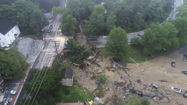 This image made from video provided by DroneBase shows damage by floodwaters near the intersection of Ellicott Mills Drive and Main Street in Ellicott City, Md., Monday, May 28, 2018. Howard County Executive Allan Kittleman said Monday morning that his priorities are finding a missing man and assessing the condition of buildings that house shops, restaurants and families. (DroneBase via AP)