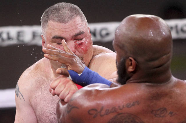 DJ Linderman, left, fights Arnold Adams during the Bare Knuckle Fighting Championship event Saturday, June 2, 2018, in Cheyenne, Wyo. The night was promoted as the first sanctioned bare-knuckle fighting in more than a century. (Jacob Byk/Wyoming Tribune Eagle via AP)