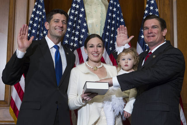 "FILE - In this Jan. 3, 2017, file photo, House Speaker Paul Ryan of Wis. administers the House oath of office to Rep. Austin Scott, R-Ga., during a mock swearing in ceremony on Capitol Hill in Washington. The Republican newcomers stunned Washington in the 2010 midterm election, sweeping into the House majority with bold and boisterous promises to cut taxes, slash spending and rollback what many viewed as Barack Obama's executive overreach of the federal of government. Scott, the class president, objects to the ""tea party"" brand he says was slapped on the group by the media and the Obama administration. It's a label some lawmakers now would rather forget. ""We weren't who you all said we were,"" Scott said.(AP Photo/Jose Luis Magana, file)"