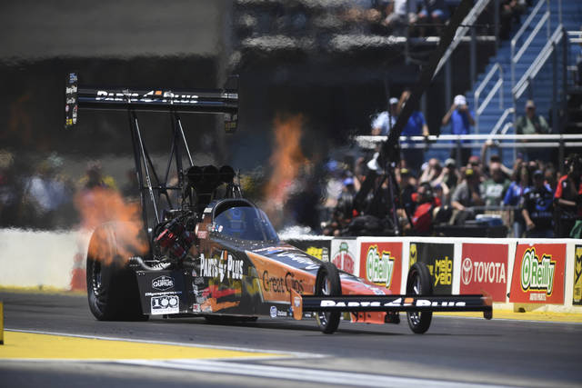 In this photo provided by the NHRA, Clay Millican picked up his second straight victory in Top Fuel on Sunday, June 3, 2018 with a win at the JEGS Route 66 NHRA Nationals at Route 66 Raceway. (Mark Gewertz/NHRA via AP)