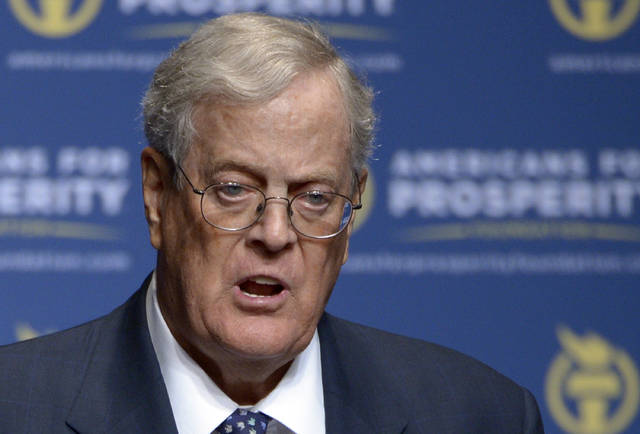FILE - In this Aug. 30, 2013 file photo, Americans for Prosperity Foundation Chairman David Koch speaks in Orlando, Fla.  Koch is stepping down from the Koch brothers network of business and political activities. The 78-year-old cited health reasons in a letter distributed to company officials on Tuesday morning.  (AP Photo/Phelan M. Ebenhack, File)