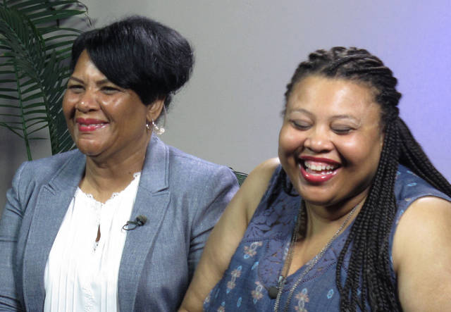 """Alice Marie Johnson, left, and her daughter Katina Marie Scales wait to start a TV interview on Thursday, June 7, 2018 in Memphis, Tenn. Johnson, 63, whose life sentence was commuted by President Donald Trump thanked him on Thursday for """"having mercy"""" and said reality TV star Kim Kardashian West saved her life.  (AP Photo/Adrian Sainz)."""