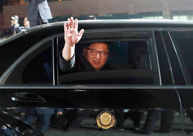 FILE - In this April 27, 2018, file photo, North Korean leader Kim Jong Un waves from a car as he returns to North Korea after the meeting with South Korean President Moon Jae-in at the border village of Panmunjom in the Demilitarized Zone. Kim is on a rare trip abroad as he leaves the all-encompassing bubble of his locked-down stronghold of Pyongyang and steps off a jet onto Singaporean soil for his planned sit-down witU.S. President Donald Trump on Tuesday, June 12, 2018. (Korea Summit Press Pool via AP, File)