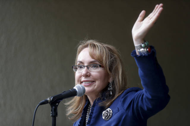 "Former U.S. Rep. Gabby Giffords waves to supporters during the ""Women for Aftab"" advocacy group kickoff event in support of Hamilton County Clerk of Courts Aftab Pureval's 1st House District challenge to veteran Republican Rep. Steve Chabot, Wednesday, June 13, 2018, in Cincinnati. Pureval pledges to support pay equity, protecting health care coverage and paid family leave. (AP Photo/John Minchillo)"