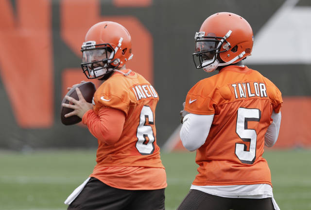 Cleveland Browns quarterbackd Baker Mayfield (6) and Tyrod Taylor (5) look to throw during practice at the NFL football team's training camp facility, Tuesday, June 12, 2018, in Berea, Ohio. (AP Photo/Tony Dejak)