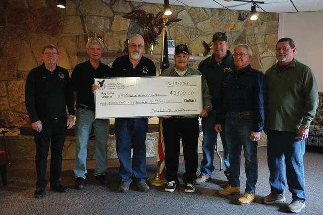 A check is presented to the Ohio Fallen Heroes Memorial by the Delaware Eagles Aerie. From left-to-right: Ken Fink, Mike Williams, Brian Hammond, OFHM founder Jerry Jodrey, Bill Cole, Jerry Myers, Niles Thompson.
