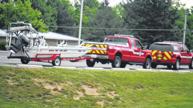 The Genoa Township Fire Department's water rescue unit pulls into the Berlin Township Fire Department parking lot near Alum Creek Lake on June 4 during a search for a missing boater.