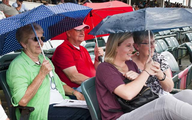 Sitting for two hours in the rain didn't dampen the fun for Caroline and Diane Welker, front row, and Joyce and Marion Wilcox, back row, watching harness racing at the Little Brown Jug Grandstands. The group said they hadn't picked any of the winning horses, but were hoping they would soon.