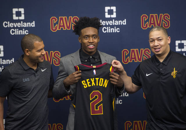 Cleveland Cavaliers first round draft selection, Collin Sexton, center, displays his jersey with Cavaliers general manager Koby Altman, left and Cavaliers head coach Tyronn Lue during a news conference at the Cavaliers training facility in Independence, Ohio, Friday, June 22, 2018.  (AP Photo/Phil Long)