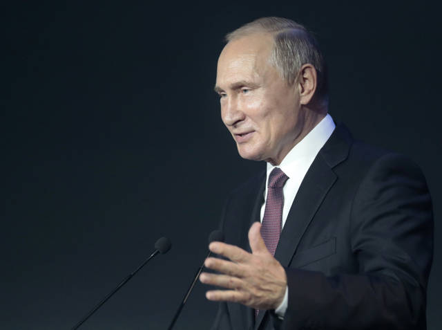 Russian President Vladimir Putin gestures while speaking at a cybersecurity conference in Moscow, Russia, Friday, July 6, 2018. Putin said it's important to develop common cybersecurity standards that take into account interests of all nations. (Sergei Chirikov/Pool Photo via AP)