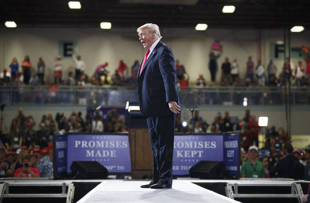 President Donald Trump calls out to the cheering crowd as he leaves a rally at the Four Seasons Arena at Montana ExpoPark, Thursday, July 5, 2018, in Great Falls, Mont. (AP Photo/Carolyn Kaster)
