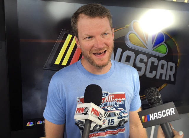 Dale Earnhardt Jr. goes through an interview during NASCAR auto racing pre-race activities at Daytona International Speedway, Friday, July 6, 2018, in Daytona Beach, Fla. (AP Photo/Mark Long)